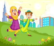 Muslim children playing in the park Stock Photo