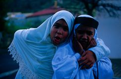 Muslim children in South Africa. The girl stands with her arm around the boy and pulling a face Stock Photos
