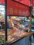 Muslim Chinese from Hui ethnic cooking stacks of meat skewers on Beiyuanmen Moslem Street stock images