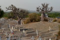 Muslim and Christian graveyard in Joal-Fadiouth, Petite Côte, Senegal. Joal-Fadiouth is a town in the Thiès Region at the southern end of the Petite Côte of Stock Images