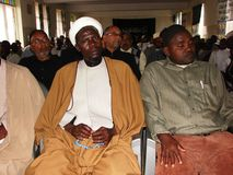 Muslim cleric listens attendively. A Shia Muslim cleric listens to a lecture in Africa Stock Photography