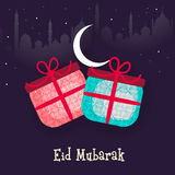 Muslim community festival, Eid Mubarak celebration with gift. Muslim community festival, Eid Mubarak celebration with floral design decorated gifts in night Royalty Free Stock Images