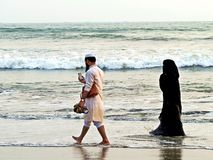 muslim couple at the beach, Coxs Bazar royalty free stock image