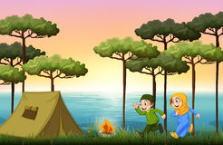Muslim couple camping in the woods Stock Photo
