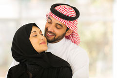 Muslim couple cuddling. Lovely young muslim couple cuddling at home Stock Images