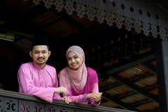 Muslim couple. With greeting hari raya Royalty Free Stock Photos