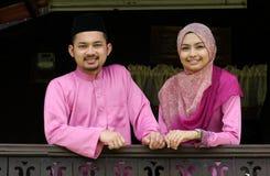 Muslim couple. With greeting hari raya Royalty Free Stock Images
