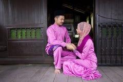 Muslim couple. With greeting Hari Raya Stock Photos