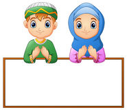 Muslim couple kid praying with blank sign Royalty Free Stock Images