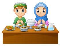 Muslim couple kid praying with blank sign Stock Photos