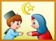 Muslim couple kid will do handshake to apologize for each other Royalty Free Stock Images