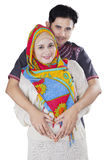 Muslim couple making heart shape in belly Royalty Free Stock Photos