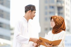 Muslim couple. Young girl and boy reading book with shopping in the city,Concept education and shopping Royalty Free Stock Photography