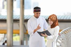 Muslim couple. Young girl and boy reading book with shopping in the city,Concept education and shopping Royalty Free Stock Image