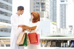 Muslim couple. Young girl and boy reading book with shopping in the city,Concept education and shopping Royalty Free Stock Photos