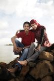 Muslim couple outdoor. Sitting on rock Stock Images