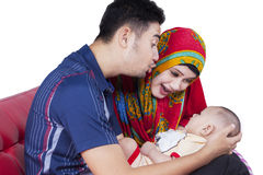 Muslim couple playing with cute baby Royalty Free Stock Images