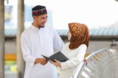 Muslim couple. Young girl and boy reading book with shopping in the city,Concept education and shopping Royalty Free Stock Images