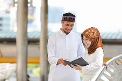 Muslim couple. Young girl and boy reading book with shopping in the city,Concept education and shopping Stock Photo