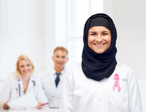 Muslim doctor with breast cancer awareness ribbon Royalty Free Stock Photo