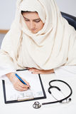 Muslim doctor in the office Stock Photos