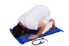 muslim doctor is praying Royalty Free Stock Photo