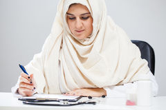 Muslim doctor during work Royalty Free Stock Photo