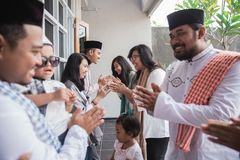 Muslim eid mubarak forgiving others. Family embracing each other during eid mubarak celebration. Forgiving stock photography