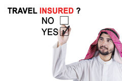 Muslim entrepreneur approving travel insured Royalty Free Stock Image