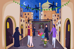 Muslim families wishing Happy Eid. Muslim families wishing Eid Mubarak,Happy Eid in vector Royalty Free Stock Photos