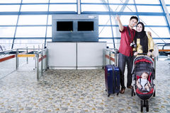 Muslim family with baby in the airport terminal Royalty Free Stock Image