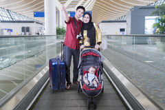 Muslim family with baby on the escalator Royalty Free Stock Photo
