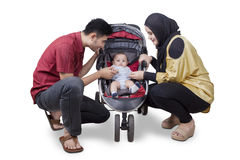 Muslim family and baby on stroller Royalty Free Stock Image