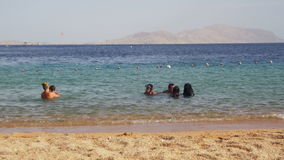 Muslim family bathes in sea stock video footage