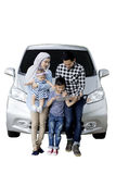 Muslim family with car and tablet on studio Royalty Free Stock Photography