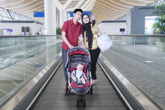 Muslim family carrying baby in the stroller Stock Image