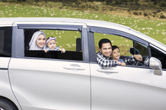 Muslim family driving a car Royalty Free Stock Photo
