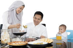 Muslim family eating at dining table Stock Photography