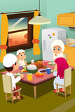 Muslim Family Eating Dinner at Home Stock Photography