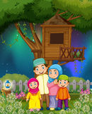 Muslim family in the garden at night Royalty Free Stock Photography