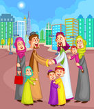 Muslim family greeting friends Stock Images