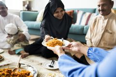 Muslim family having dinner on the floor royalty free stock photography