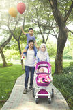 Muslim family is having fun in the park Stock Photos