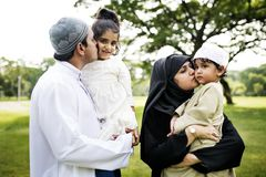Muslim family having a good time outdoors royalty free stock photography