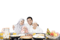 Muslim family having meal at dining table Stock Photography