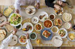 Muslim family having a Ramadan feast royalty free stock photography