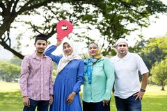 Muslim family holding up a check point symbol stock images