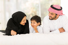 Muslim family lying Stock Images