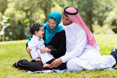 Muslim family outdoors. Cheerful muslim family sitting outdoors Stock Photography