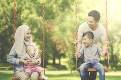 Muslim family playing in the playground Royalty Free Stock Images